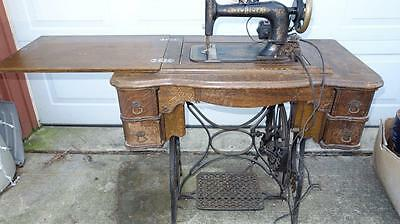 Antique New Home Sewing Machine With Cast Iron Base And Wood Cabinet