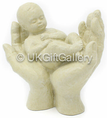 Baby Resting in Hands Figurine Neutral Cream Finish Interesting New Baby Gift
