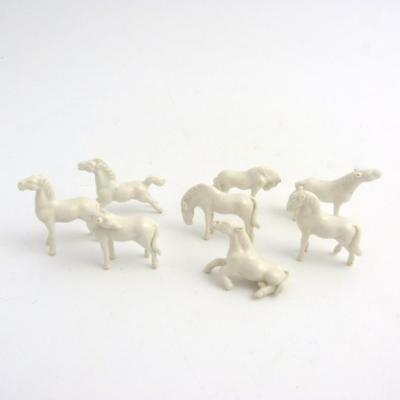 Set Of Chinese Miniature Porcelain Figures Of The Eight Horses Of Mu Wang