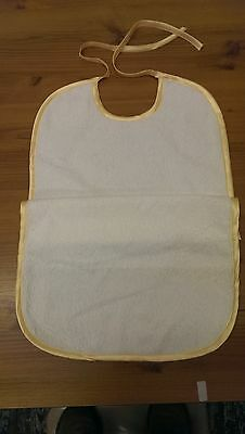 Washable towelling bib with waterproof backing-binding and tie fastening