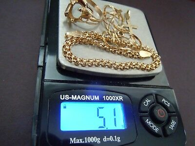 SCRAP GOLD; 14K SOLID YELLOW GOLD; 5.1 grams TOTAL WEIGHT