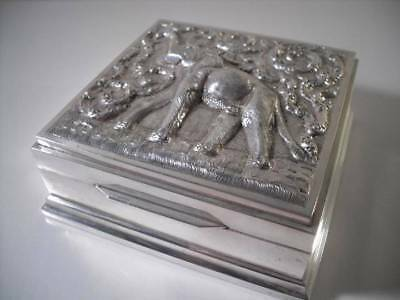 An Oriental Silver Box With Embossed Elephant & Walnut Interior: S.E. Asia c1900