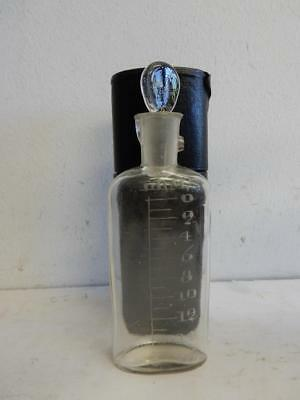 really old chemist glass bottle in leather case