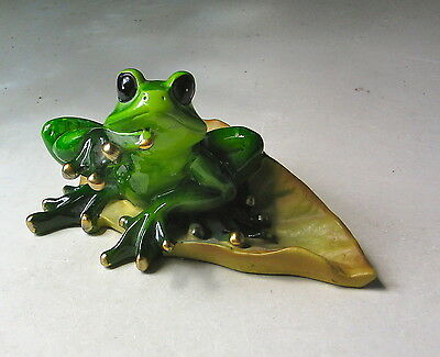 Green Frog With Gold Nails Sitting On A Leaf Figurine