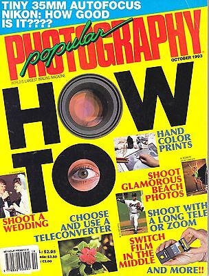 Popular Photography magazine with Canon & Minolta wide zooms tested   Oct 1993