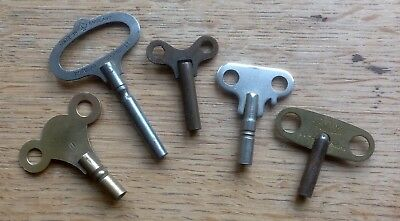 Five OLD Brass/steel CLOCK KEYS, one size 7, one 11, and three, sizes not marked