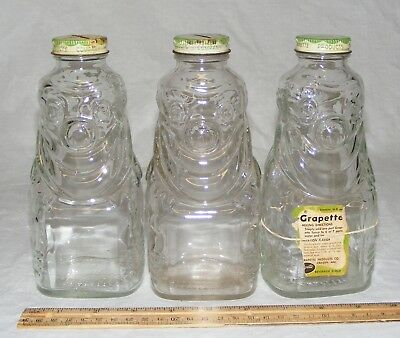 Lot of 3 1950s Grapette soda syrup clown bottles with coin bank lids Hazel-Atlas