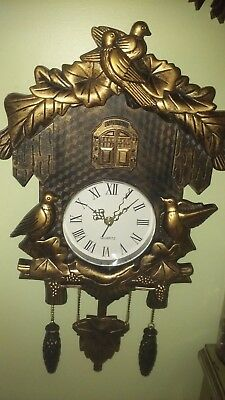 classic bavarian cuckoo clock,,,gold hard plastic, collections etc, works