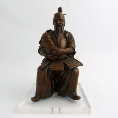 Japanese Spelter Figure Of A Seated Samurai Holding A Child, Meiji Period