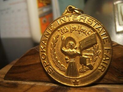 "Spokane Interstate Fair Medal  Vintage LADY HOLDING LETTER ""IT's FOR YOU"""