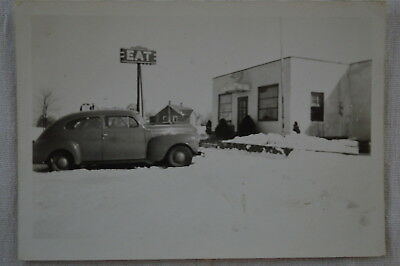 Vintage Car Photo 1940 Plymouth by EAT sign at Roadside Diner in Snow 83756