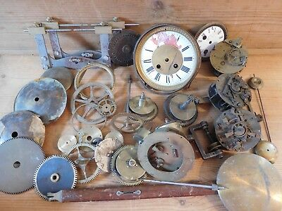 Four Old Clock movements and other clock parts and tools
