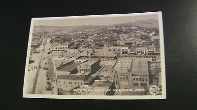 Photo Postcard--ARIZONA--Nogales--Birdseye View of Town Buildings Fence Border