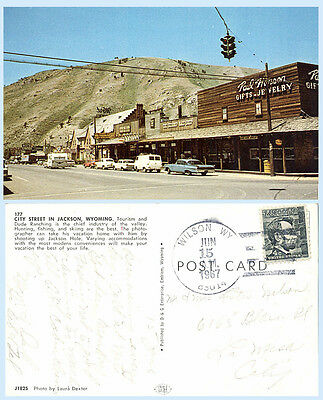 City Street Jackson Wyoming dated 1967 Postcard Cars Signage Stores