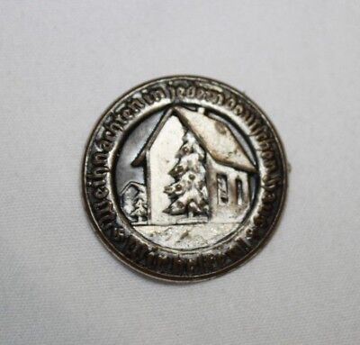 ~German Undated Christmas Pin Badge. A Home & Trees in Snow on Tin Badge