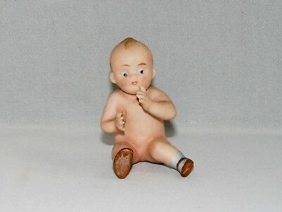 ANTIQUE, HAND PAINTED PORCELAIN, BABY PIANO DOLL, No P49.