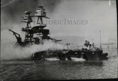 1942 Press Photo Crewmen of the U.S.S. Nevada fighting flames on the battleship