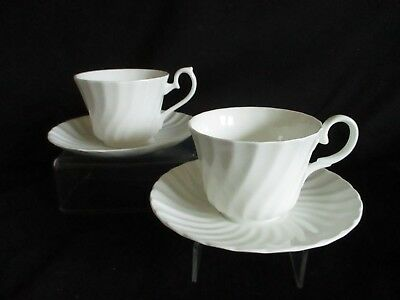 Vintage white china English Bone china mismatched fluted tea cups & saucers x 2