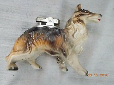 Used Table Lighter inside what looks to be a Long Haired Collie Dog, repaired