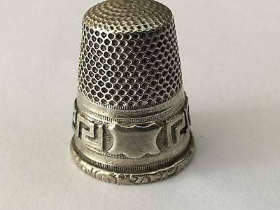 antique Continental  silver thimble with applied Greek Key and shield