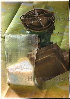 1994 Press Photo Package of rice with a camp stove and map - mjb16000