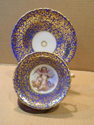 Antique Cup & Saucer Hand Painted Cherub Center Blue & Gold Ground
