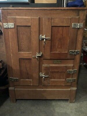 Vintage antique wood ice chest dates to the early 1900's. All original hardware