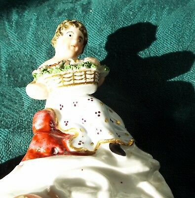 Early staffordshire figure girl with flowers  circa 1800