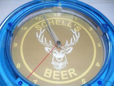 "Schell's beer blue tube lighted clock deer head on the front, 10"" long, works"