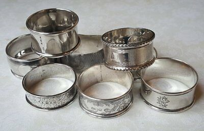 Eight Antique Sterling Silver Mismatched Napkin Rings