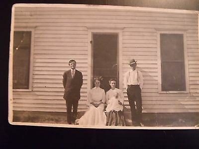 Vintage Postcard Rppc Real Photo Family? Two Men,two Women Baby Sitting On Step