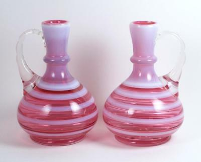 Art Glass Ewer Pair Cranberry Glass Pink and White Stripes Clear Glass Handles