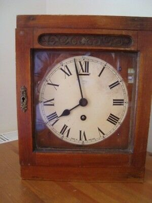 Vintage Wall Or Mantlepiece Clock In Wooden And Glazed Case Case.
