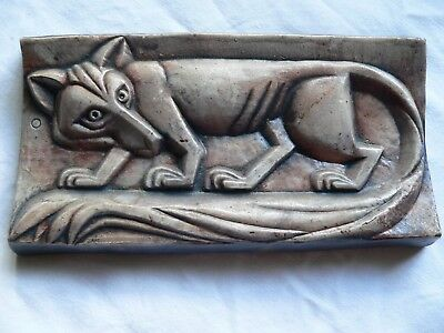 A Rare Art Deco Clay Wall Plaque With stylized Fox On It