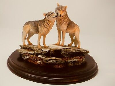 """Wolves Ceramic Figurine """"The Kiss"""" with beautiful wooden base."""
