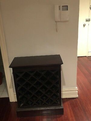 Dark wooden wine rack