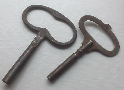 TWO OLD STEEL CLOCK KEYS, one marked 9, the other 5mm approx square winding tip