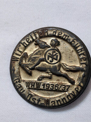 Round magnetic  PinBack maybe a  Tinnie1936/37 Man on Horse