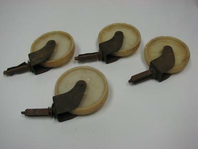 Vintage Mid Century 4 Snap In Swivel Casters Wheels off white Plastic, Steampunk
