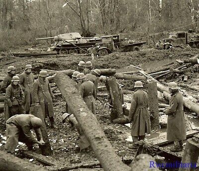 Port. Photo: NEAT! Wehrmacht Troops Clear Logs by KO'd Russian T-34 Panzer Tank!