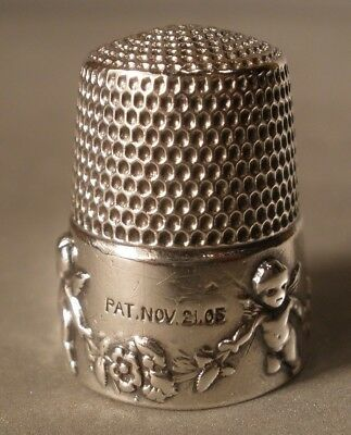 Simons Brothers Sterling Thimble with Cupids
