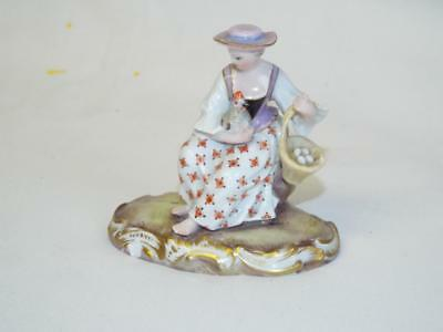 Small antique Meissen figurine of a woman with hen & basket of eggs.