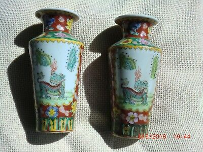 Vintage Pair of Chinese ,Kylin Decorated Vases .