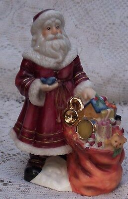 "Coyne's & Co. Bavarian Heritage Porcelain Santa Figurine ""Warm With Love"" 1998"