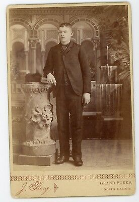 Handsome young man in formal portrait   . Antique cabinet card  photograph