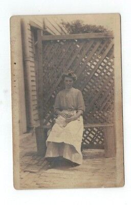 Antique 1913 real photo rppc post card woman sits with cat on her lap