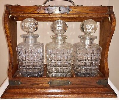 Beautiful Antique English Tantalus Wood with Three Glass Decanters and Case Key