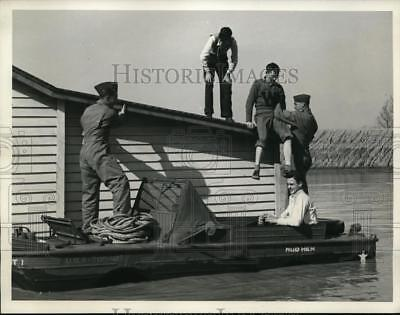 1943 Press Photo Larry Harris helped off roof of flooded home in Ft Knox KY