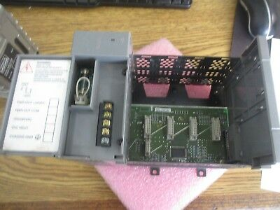 Allen Bradley SLC500 Cat. #: 1746-A4. 4-Slot Chassis w/ 1746-P1 Power Supply <