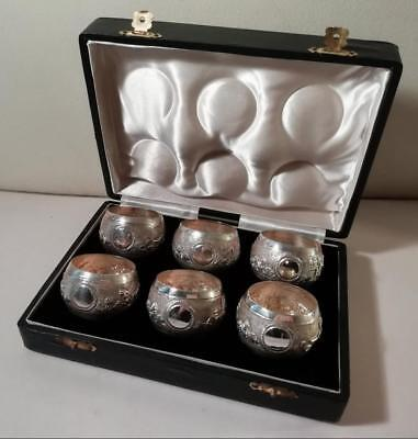 A Cased Set of Six Sterling Silver Napkin Rings w. Embossed Decoration : c1910